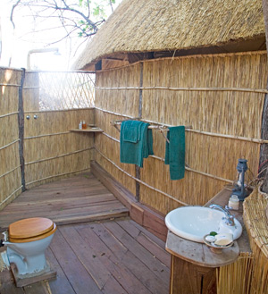 Zambia bush bathrooms: open-air ones like this at Nsolo Camp are suited to Zambia's warm weather.