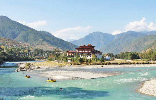 Authentic luxury travel is rafting in Bhutan.