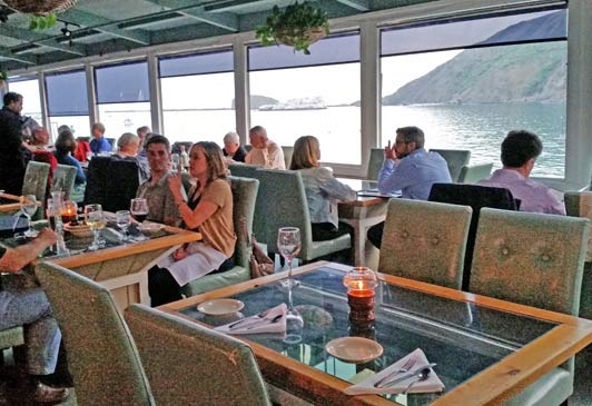 At the Olde Port Inn, glass top tables allow underwater viewing during meals.