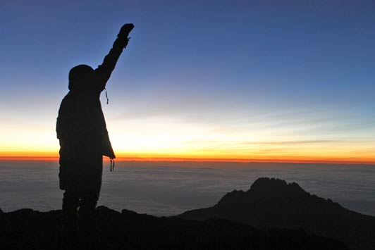"""Standing on the """"Roof of Africa"""" at sunrise."""