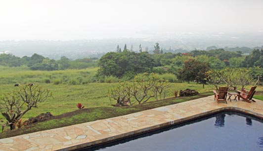 Holualoa Inn, a Big Island boutique hotel, provides a panoramic view across a coffee plantation to the ocean.