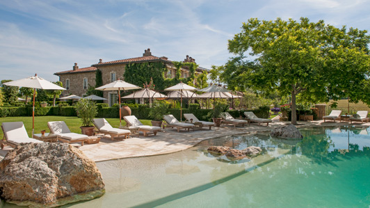The Borgo swimming pool provides a view over the hills of Tuscany.