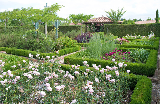 Flower gardens cover the grounds at this stunning Tuscan estate.