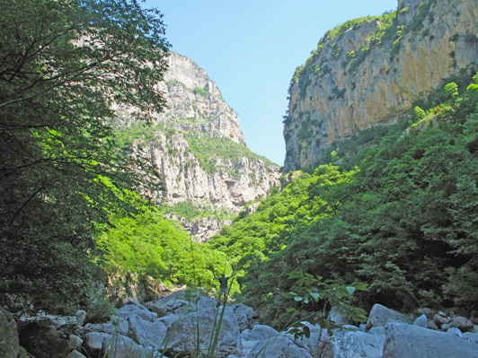 Here, Dino - walking Vikos Gorge - is dwarfed by the grand mountain scenery.
