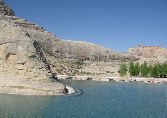 The Amangiri pool flows around natural rock formations.
