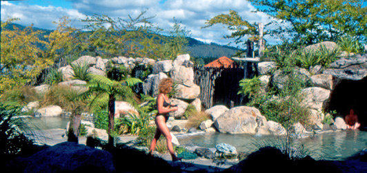 New Zealand spas - like this one in Rotorua - are a great way for authentic travelers to connect with the natural environment.