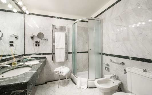 Grand hotels in Florence Italy often have large marble bathrooms - like this one at Hotel Degli Orafi.