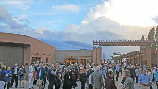 Opera patrons in the plaza outside the theatre before Don Pasquale.