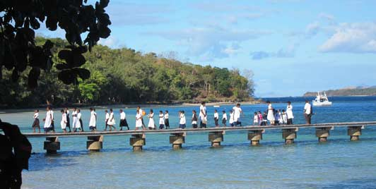 Village kids - some the children of staff members - arrive on Turtle Island for a concert.