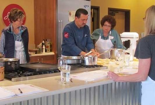 Chef Noe Cano demonstrates tamale-making technique at the Santa Fe School of Cooking. Photo courtesy of the Santa Fe School of Cooking.