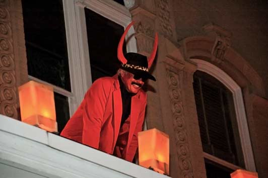 Roger Atkins obviously enjoyed some holiday fun portraying a devil during Santa Fe's annual Las Posadas. Photo courtesy of the New Mexico History Museum.