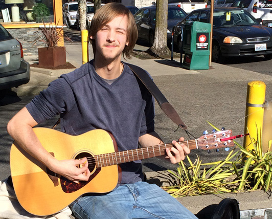 This Portland street musician expected the unexpected - a job - and got it.