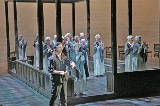 Erik Van Heyningen (front) as The Jailer with nuns of Compiègne in Opera Theatre of Saint Louis' 2014 production of Dialogues of the Carmelites. Photo by Ken Howard.