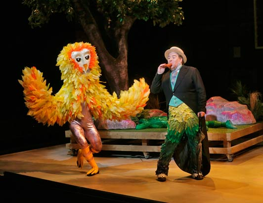 (L to R) David Gonsier as an owl and Levi Hernandez as Papageno in Opera Theatre of Saint Louis' 2014 production of The Magic Flute. Photo Ken Howard.