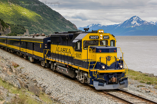 Alaska Railroad sightseeing trip making its way north along the Seward Highway. Passengers enjoy snow-capped mountain and glacier views, as well as wildlife such as Dall Sheep, moose, eagles, and the occasional bear. Credit: Victoria Lynn Pennick.
