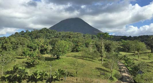 "Arenal - currently in a ""resting stage"" - provides mountains to hike, lakes to fish and rivers to float."