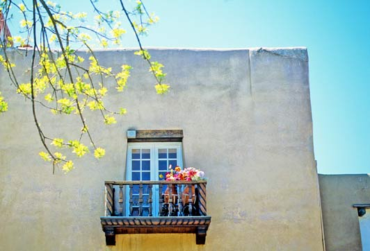 As you wander around Santa Fe this summer, be on the lookout for classic balconies like this one.