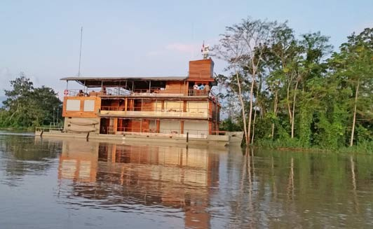 This is Delfin I. The Amazon River fleet also includes Delfin II with 14 suites.