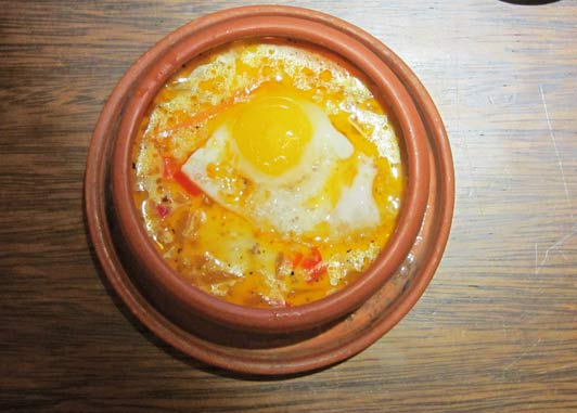 Quinoa soup with poached quail egg in Urubamba in the Sacred Valley of Incas, Peru.