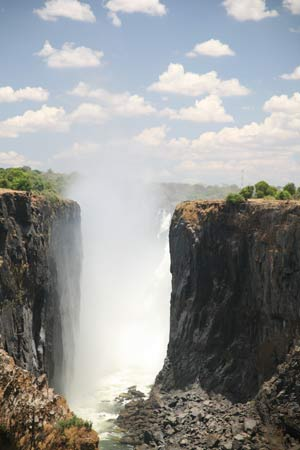 Victoria Falls is located between Zambia and Zimbabwe in Africa.