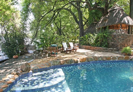 The pool at Tongabezi is made from local stone and blends with the environment.
