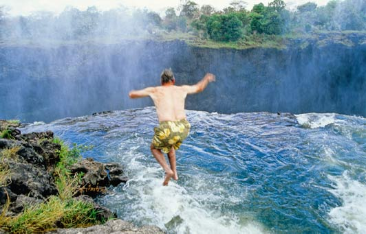 Richard, the daredevil, jumping into Devil's pool at the top of Victoria Falls.