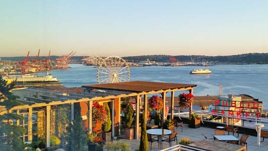Seattle Great Wheel and ferries crisscrossing Puget Sound are best viewed from the roof deck at Inn at the Market.