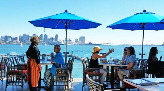 Patio seating at Coasterra offers a panoramic harbor vew.