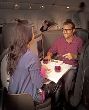 Business-PremierMan-and-woman-share-meal-edited-for-ALT-airline-tickets