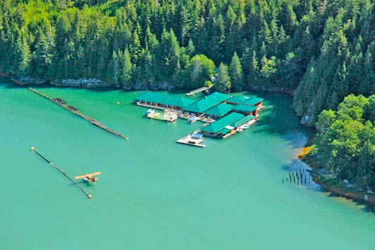 The one story Knight Inlet Lodge floats serenely in the midst of a vast wilderness.