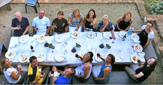 Dinner in Tuscany after a day of sightseeing, cooking lessons, wine tasting, and yoga poses