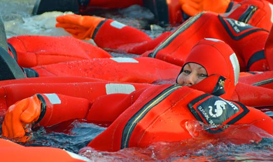 Here's Norma and other icebreaker passengers looking like orange gummy bears in their rescue suits.