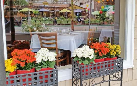 Two popular restaurants in La Jolla Shores: Barbarella reflected in Piatti's picture window.