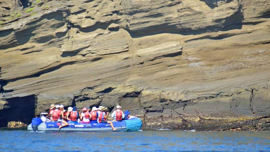 Eclipse passengers taking a panga to get close to Galapagos wildlife.