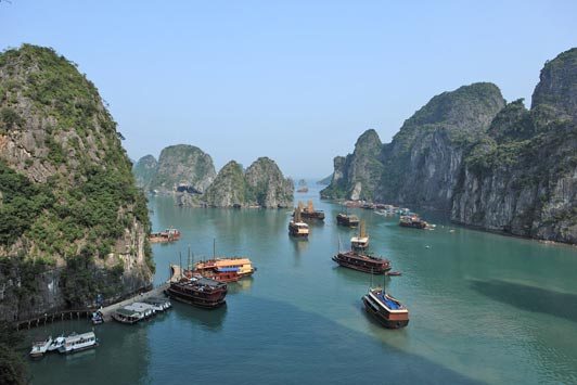 Halong Bay is a beautiful area in the northern part of  Vietnam where sailing junks dot the sea.