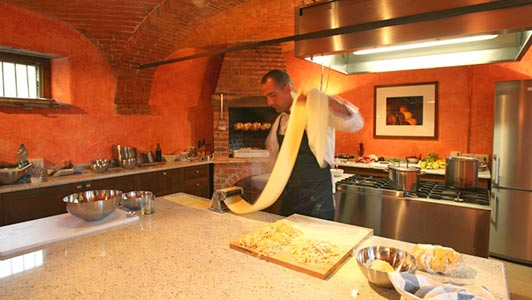 """Making pasta in professional chef's kitchen with """"fireplace rotisserie."""""""