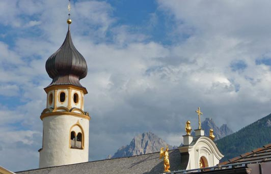 San Candido is one of the picturesque spots passed by those walking in the Dolomites.