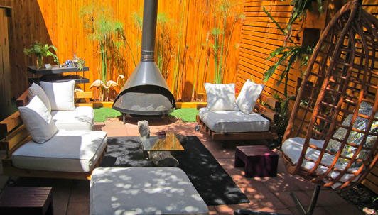 The big surprise of the 2014 Secret Garden Tour? This charming patio - innovatively furnished with re-purposed materials -surrounding a tiny bungalow.